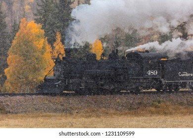 OCTOBER 9, 2018 - New Mexico, USA - Cumbres & Toltec Scenic Steam Train, from Chama, New Mexico to Antonito, Colorado over Cumbress Pass 10,015 Elevation - in Autumn and fresh snow - along Highway 17