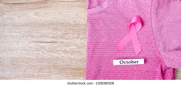 October Breast Cancer Awareness month,  Pink Ribbon on pink shirt for supporting people living and illness. Healthcare, International Women day and World cancer day concept