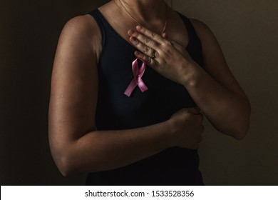 October is breast cancer awareness month,a woman holds a pink ribbon to support people living and sick.Health, international women's day and the concept of the world day of fight against cancer.Noise