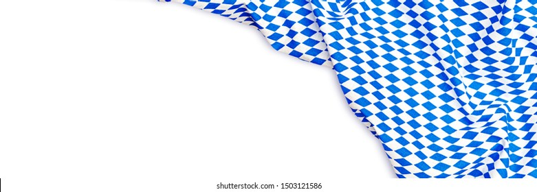 October fest background with blue white cloth, banner. Oktoberfest background frame with bavarian white blue fabric, isolated on white. October fest background, text place, copy space.