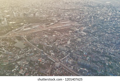 October12,2018 Bangkok Thailand, Aerial Shot of BangSue Grand Central Train Station in Bangkok, Morning sunrise in bangkok landscape from airplane window with lens flare, New infrastructure in Bangkok