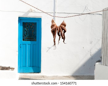 Octopus hanging outside a restaurant in Milos, Greece