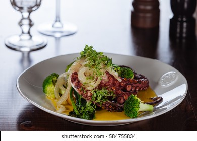 Octopus in olive oil extra virgem, garlic and parsley, with greens/Traditional Portuguese cuisine