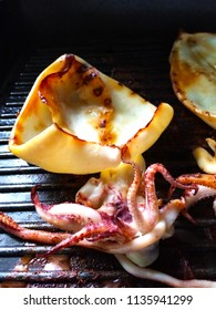 Octopus on grill pan is coated with oil. Easy grilled octopus on pan,simple grill seafood.