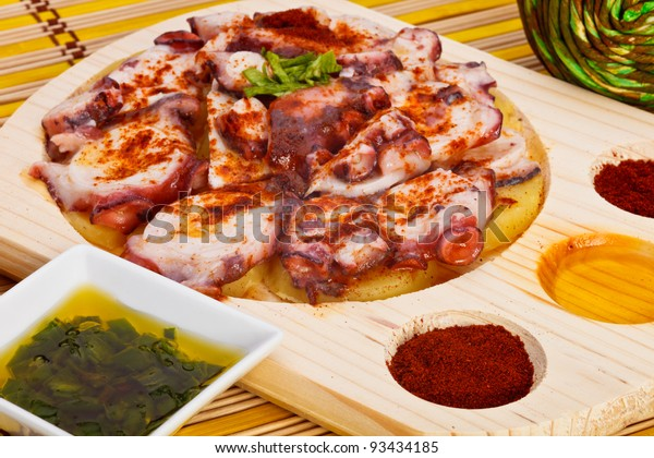 Octopus with paprika, potatoes and olive oil typical of Galicia, Spain