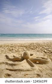 A octopus sand sculpture on a beach