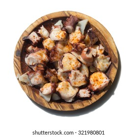 Octopuss on wooden plate - Typical spanish food Isolated