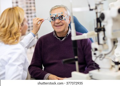 Ocular female specialists work with patient in pleasant atmosphere on eye clinic