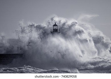 Od lighthouse embraced by stormy waves. Douro river mouth, Porto, Portugal. Used infrared filter. Toned blue.
