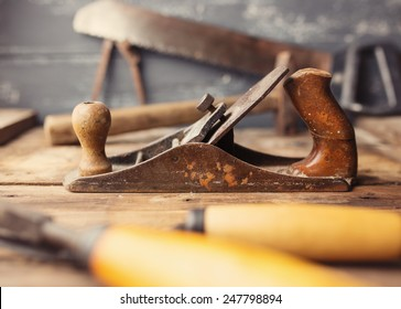 Od vintage hand tools on wooden background. Focus on jack-plane. Carpenter workplace. Tinted photo