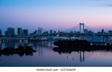 Odaiba Island at dawn. View of the rainbow bridge. Early morning.