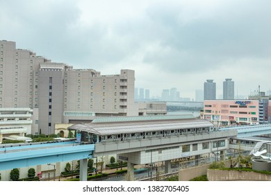 Odaiba, Japan - 11 April 2019 - Odaiba monorail trains stop at a station to send and pick up passengers in Odaiba, Japan on April 11, 2019