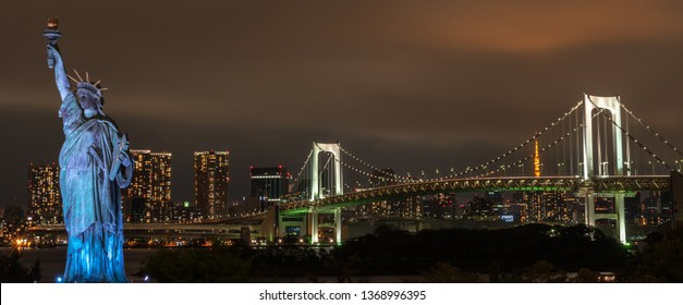 ODAIBA, JAPAN - APR 15, 2018 : Statue of Liberty located in Odaiba, since 2000. It is meant to show the strongest relationship between Japan and France. Beautiful night view of Odaiba,
