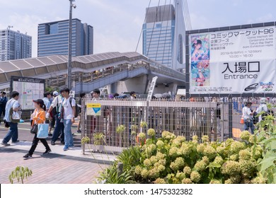 Odaiba, Japan- August 10, 2019: People walk out the entrance of the comiket event in Odaiba.