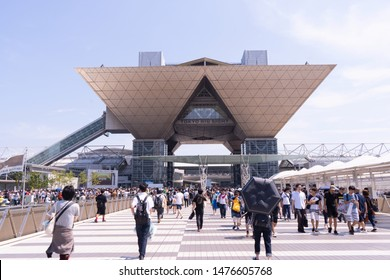 Odaiba, Japan- August 10, 2019: People walk towards the tokyo big sight building in Odaiba.