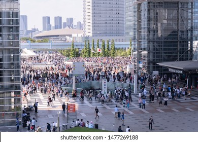 Odaiba, Japan- August 10, 2019: People walk around the Tokyo Big Sight in Odaiba.