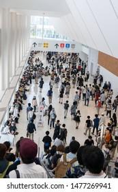 Odaiba, Japan- August 10, 2019: People walk through the halls of the Tokyo Big Sight in Odaiba.