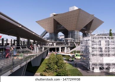 Odaiba, Japan- August 10, 2019: People walk towards the Tokyo Big Sight in Odaiba.