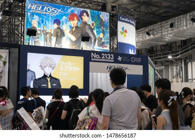 Odaiba, Japan- August 10, 2019: People line up in front of a booth, during an event, in Odaiba.
