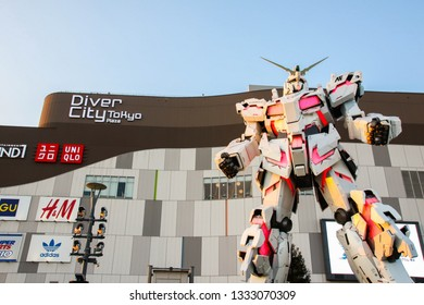 ODAIBA, JAPAN - FEBRUARY 18, 2019 :  RX-0 Unicorn Gundam scale 1:1 in Destroy mode statue display in front of DiverCity Tokyo Plaza in Odaiba, Tokyo.