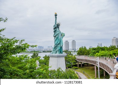 Odaiba, Japan - June 14, 2018 - Odaiba Rainbow Bridge, Statue Of Liberty Replica, Japan. Image For Templates, Placards, Banners, Presentations, Reports, Card And Wallpaper. etc.