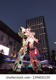 Odaiba, Japan - March 21, 2019 : Unicorn Gundam standing in front of the Diver City Tokyo Plaza at Odaiba city at night.