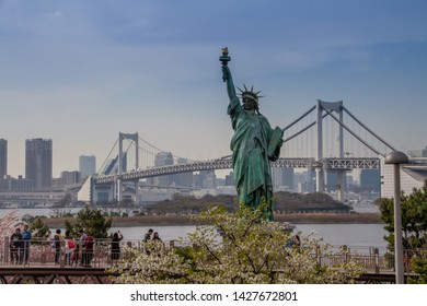 Odaiba, Japan on April 6, 2016. View of the statue of liberty during cherry blossom season.