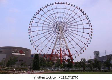 Odaiba, Japan-August 3, 2018: A ferris wheel spins as the sky turns dark.