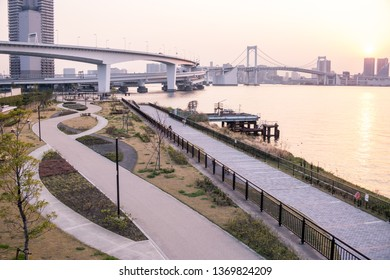 Odaiba, Tokyo, Japan, 04/06/2019 , Highway to the Rainbow Bridge, connecting Odaiba with Tokyo during sunset.