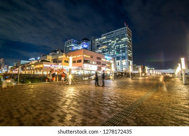 Odaiba, Tokyo / Japan : July 30, 2018: Beautiful night view of Odaiba sky walk with a background of Aqua City  Shopping center and FUJI TV tower.