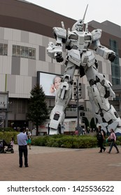 Odaiba, Tokyo / Japan: Jun 2 2019: Tourists and locals taking pictures with the 1:1 scale unicorn gundam at Odaiba