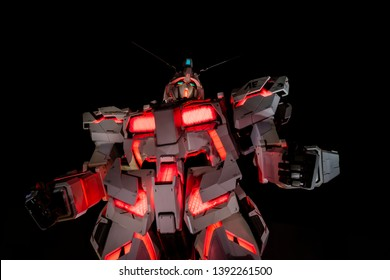 ODAIBA, Tokyo, JAPAN - March 25, 2019 : Mobile suit Unicorn Gundam model robot biggest size glowing red light at night at Tokyo Diversity at Odaiba the famous landmark and place to visit Japan.