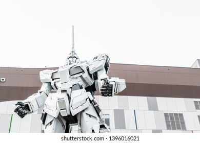 ODAIBA, Tokyo, JAPAN - March 25, 2019 : Mobile suit Unicorn Gundam model robot biggest size in front of Tokyo Diversity at Odaiba the famous landmark and place to visit Japan.