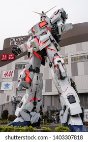 ODAIBA, Tokyo, JAPAN - March 25, 2019 : Mobile suit Unicorn Gundam model robot biggest size with red light in front of Tokyo Diversity at Odaiba the famous landmark and place to visit Japan.