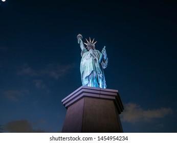 Odaiba, Tokyo, Japan - November 22, 2018 : Odaiba Statue of Liberty Replica Small-scale copy of the Statue of Liberty, with views of the Rainbow Bridge & the Tokyo skyline.- Image