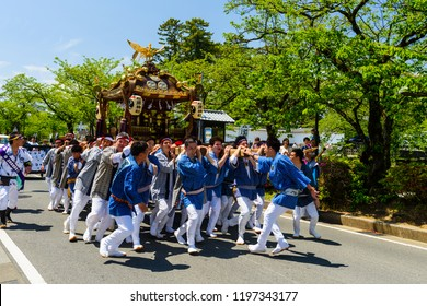 Odawara, Japan - May 05, 2017: Japanese people raise and parade portable float shrine in town for praying prosperity and happiness. This is festival tribute to Hojo Soun, brave warlord in 16 century.