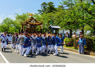 ODAWARA, JAPAN - MAY 05, 2017:Unidentified Japanese people parade portable shrines in town for praying prosperity and hapiness. This is festival tributed to Hojo Soun, brave warlord in the 16 century.