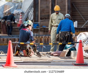 ODAWARA, JAPAN - NOVEMBER, 11, 2017: Builders on a city street. Copy space for text