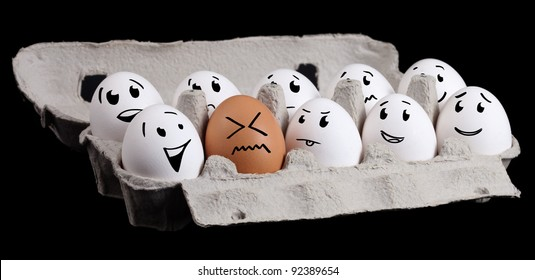 The odd one, funny eggs with smiley faces