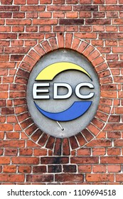 Odder, Denmark - April 2, 2018: EDC logo on a wall. EDC is Denmark's largest and oldest real estate chain formed in 1971 with 232 independent real estate agencies
