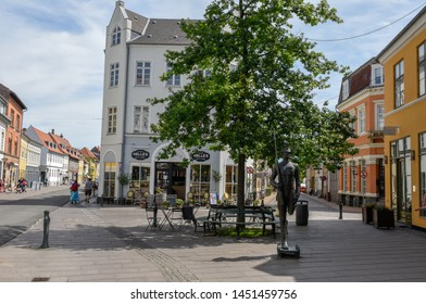 Odense, Denmark - 24 June 2019: people shopping in the old houses of Odense on Denmark