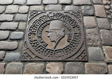 Odense, Denmark - April 9, 2017: Manhole cover with the Danish autor Hans Christian Andersen in Odense, Denmark