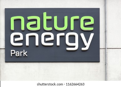 Odense, Denmark - August 16, 2018: Nature Energy Park sign on a wall. Nature Energy Park also known as Odense Stadion is an association football stadium located in Odense, Denmark