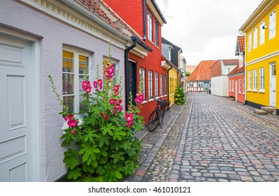 Odense, Denmark - July 21, 2015: Traditional houses and flowers in the old town