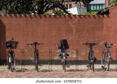 Odense, Denmark - June 20, 2017: Bicycles are the most used way of transport in Denmark. Bicycles parking. Danish lifestyle. Environmentally friendly way of transport.