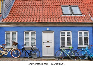 Odense / Denmark - September 3, 2016: Bicycles and colorful facade