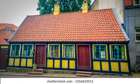 Odense, Funen / Denmark - 07 24 2016: Hans Christian Andersen childhood home in the historic city center of Odense with traditional old Danish timber framing houses.