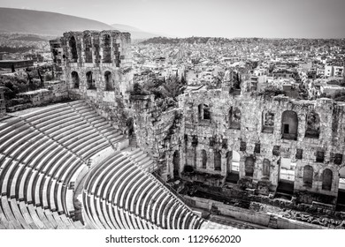 Odeon of Herodes Atticus at the Acropolis of Athens in black and white, Greece. This ancient Greek theatre is one of the main landmarks of Athens. Ruins of famous Odeon overlooking the Athens city.