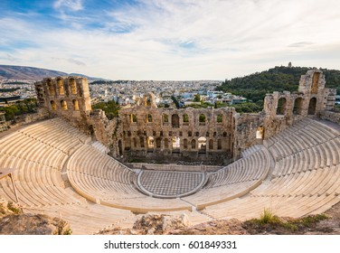 Odeon of Herodes Atticus on Acropolis hill in Athens, Greece with view on the city, sunset light and soft focus