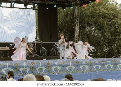 ODESA, UKRAINE - July 28, 2018: Children perform at open summer theater in front of parents and guests. Children's theatrical creativity, choreography and vocal, school children's amateur performance